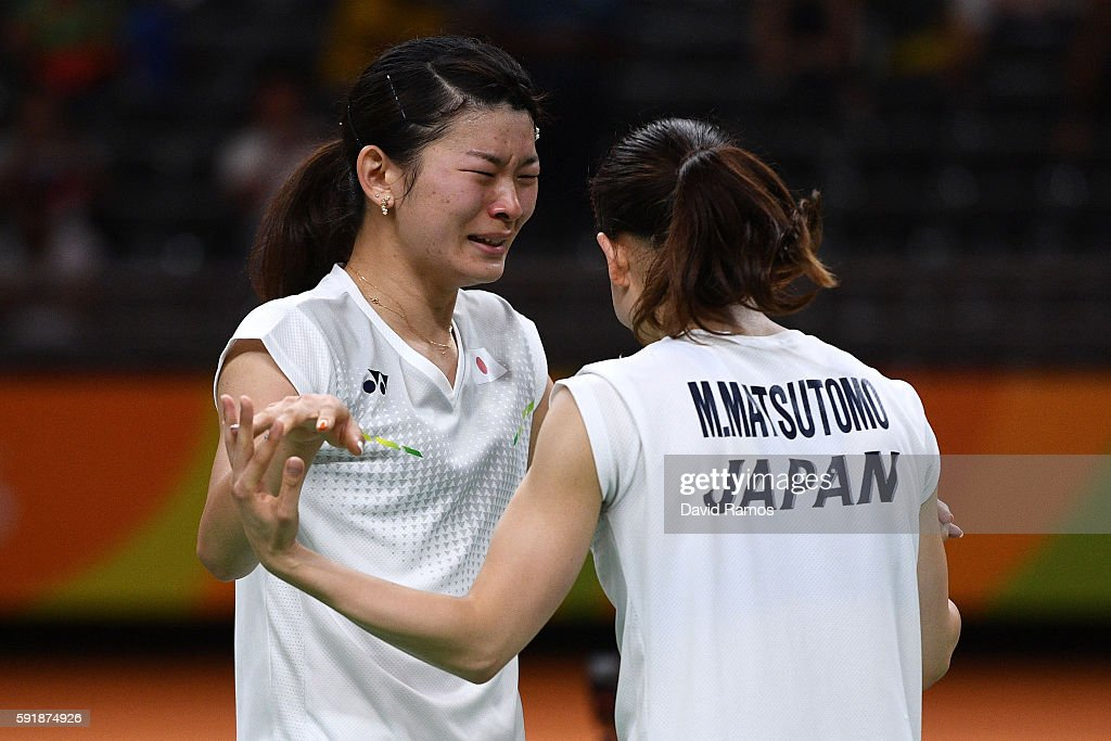 Misaki Matsutomo and Ayaka Takahashi of Japan celebrate winning match point against Christinna Pedersen and Kamilla Rytter Juhl of Denmark during the Women's Doubles Badminton Gold Medal Match on Day 13 of the Rio 2016 Olympic Games at Riocentro - Pavilion 4 on August 18, 2016 in Rio de Janeiro, Brazil.