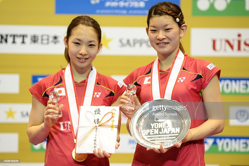 <a gi-track='captionPersonalityLinkClicked' href=/galleries/search?phrase=Misaki+Matsutomo&family=editorial&specificpeople=6831788 ng-click='$event.stopPropagation()'>Misaki Matsutomo</a> (L) and <a gi-track='captionPersonalityLinkClicked' href=/galleries/search?phrase=Ayaka+Takahashi&family=editorial&specificpeople=8671069 ng-click='$event.stopPropagation()'>Ayaka Takahashi</a> (R) of Japan celebrate with the gold medal on the podium during day six of Badminton YONEX Open on June 15, 2014 in Tokyo, Japan.