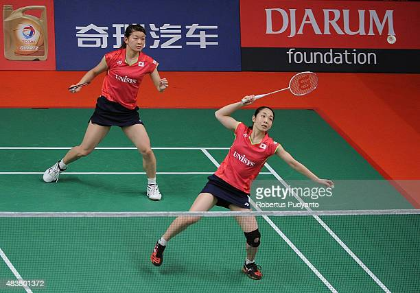 Misaki Matsutomo and Ayaka Takahashi of Japan compete against Amelia Alicia Anscelly and Soong Fie Cho of Malaysia in the 2015 Total BWF World...
