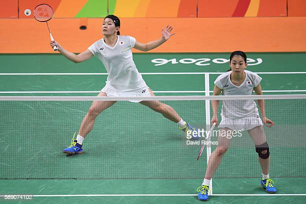 Misaki Matsutomo and Ayaka Takahashi of Japan compete against Eefje Muskens and Selena Piek of Netherlands during the Women's Doubles Play Stage...
