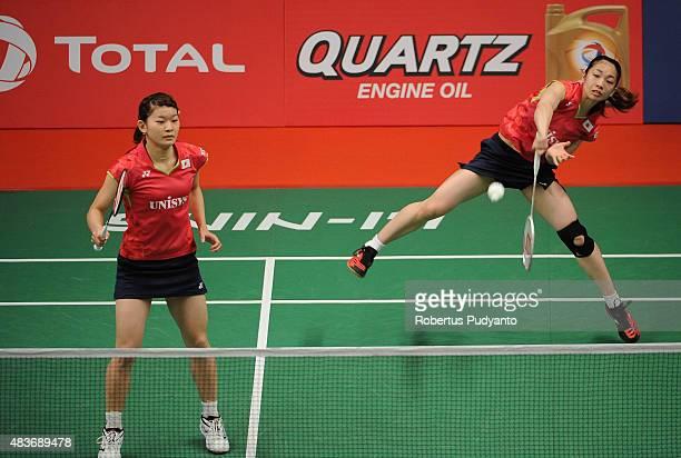 Misaki Matsutomo and Ayaka Takahashi of Japan compete against Joyce Wai Chi Choong and Yap Cheng Wen of Malaysia in the 2015 Total BWF World...