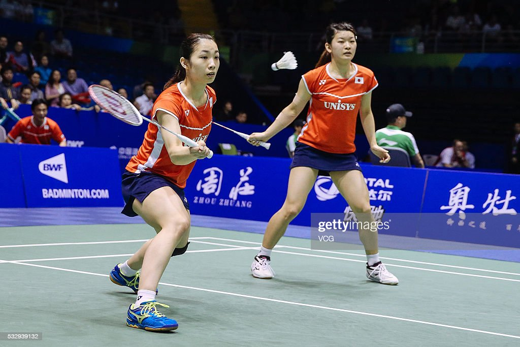 <a gi-track='captionPersonalityLinkClicked' href=/galleries/search?phrase=Misaki+Matsutomo&family=editorial&specificpeople=6831788 ng-click='$event.stopPropagation()'>Misaki Matsutomo</a> and <a gi-track='captionPersonalityLinkClicked' href=/galleries/search?phrase=Ayaka+Takahashi&family=editorial&specificpeople=8671069 ng-click='$event.stopPropagation()'>Ayaka Takahashi</a> of Japan compete during the women's doubles match against Christinna Pedersen and Kamilla Rytter Juhl of Denmark in the Uber Cup quarter final match on day five of Thomas & Uber Cup 2016 at Kunshan Sport Center on May 19, 2016 in Kunshan, Jiangsu Province of China.