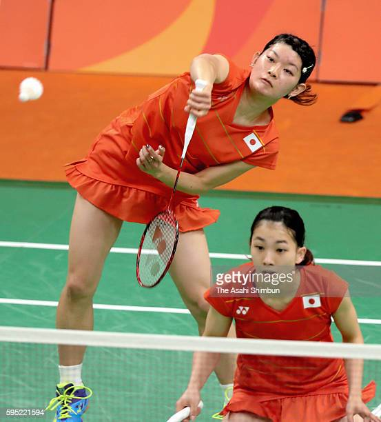 Misaki Matsutomo and Ayaka Takahashi of Japan compete in the Women's Doubles Quarterfinal match against Vivian Kah Mun Hoo and Khe Wei Woon of...