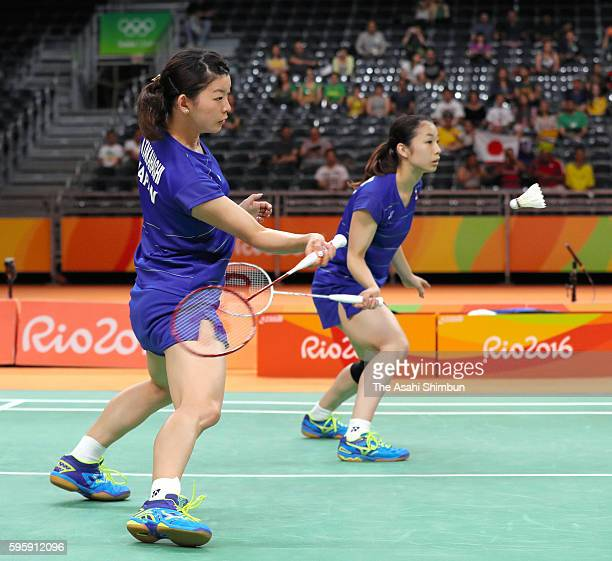 Misaki Matsutomo and Ayaka Takahashi of Japan compete in their Doubles Semifinal match against Kyung Eun Jung and Seung Chan of Korea on Day 11 of...