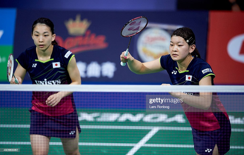 Misaki MATSUTOMO and Ayaka TAKAHASHI of Japan in action during Day Two at the MetLife BWF World Superseries Premier Yonex Denmark Open Badminton at Odense Idratshal on October 14, 2015 in Odense, Denmark.