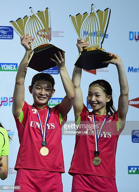Misaki Matsutomo and Ayaka Takahashi of Japan lift their throphies after beating Tian Qing and Zhao Yunlei of China in the Womens Doubles Final...