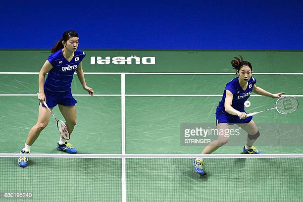 Misaki Matsutomo and Ayaka Takahashi of Japan play against Chen Qingchen and Jia Yifan of China during their women's doubles final match on the 5th...