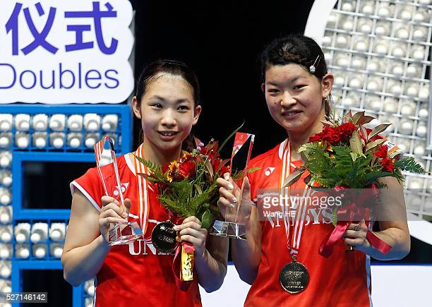 Misaki Matsutomo and Ayaka Takahashi of Japan pose with their gold medals on the podium after winning the women's doubles final match against Naoko...
