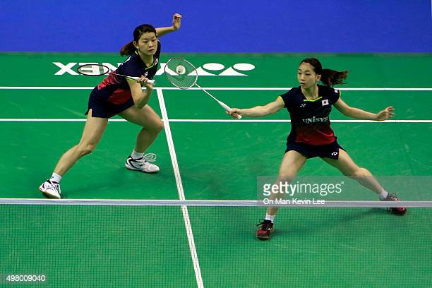 Misaki Matsutomo and Ayaka Takahashi of Japan return a shot during the match between Misaki Matsutomo and Ayaka Takahashi of Japan and Naoko Fukuman...