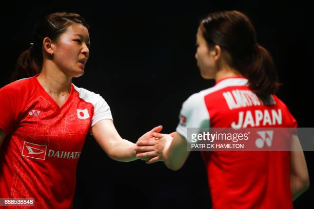 Misaki Matsutomo of Japan and partner Ayaka Takahashi of Japan celebrate a point during the women's doubles Sudirman Cup match against Vivian Hoo and...