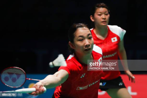 Misaki Matsutomo of Japan hits a return during the women's doubles Sudirman Cup match with partner Ayaka Takahashi against Vivian Hoo and Woon Khe...