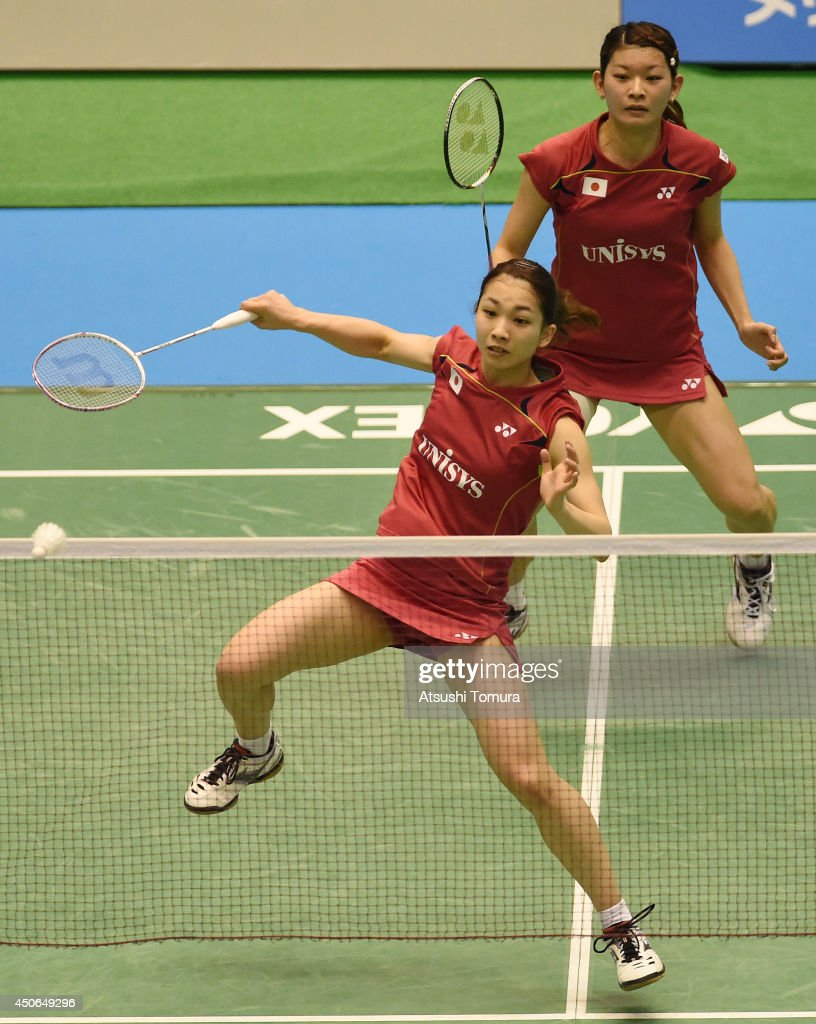 <a gi-track='captionPersonalityLinkClicked' href=/galleries/search?phrase=Misaki+Matsutomo&family=editorial&specificpeople=6831788 ng-click='$event.stopPropagation()'>Misaki Matsutomo</a> of Japan returns a shot as team mate <a gi-track='captionPersonalityLinkClicked' href=/galleries/search?phrase=Ayaka+Takahashi&family=editorial&specificpeople=8671069 ng-click='$event.stopPropagation()'>Ayaka Takahashi</a> watches on against Reika Kakiiwa and Miyuki Maeda of Japan during day six of Badminton YONEX Open on June 15, 2014 in Tokyo, Japan.