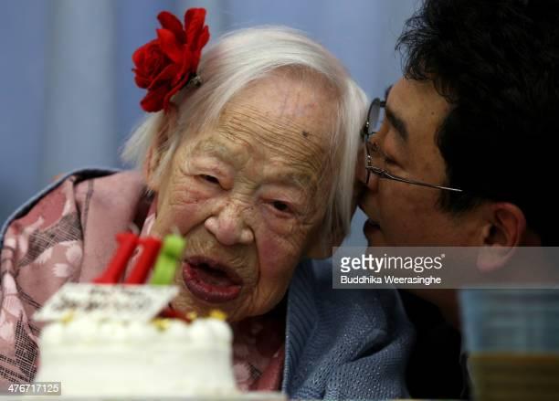 Misao Okawa the world's oldest Japanese woman listens to Manager Okada Tomohito of Kurenai Nursing Home on her 116th birthday celebration at Kurenai...