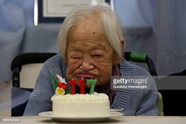 Misao Okawa the world's oldest Japanese woman waits to mark her 117th birthday celebration next to her birthday cake at Kurenai Nursing Home on March...