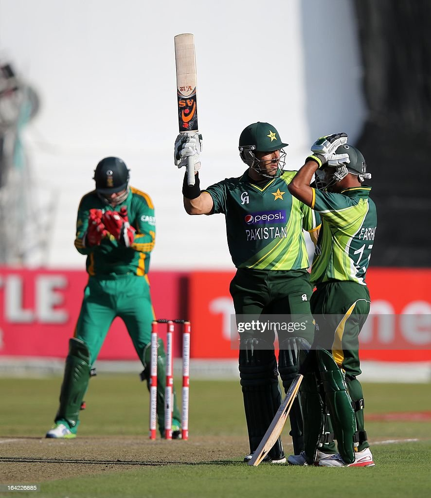 Misbah ul Haq of Pakistan raises his bat to celebrate his 50 runs during the ODI match between South Africa and Pakistan at Sahara Stadium Kingsmead on March 21, 2013 in Durban, South Africa AFP PHOTO / Stringer