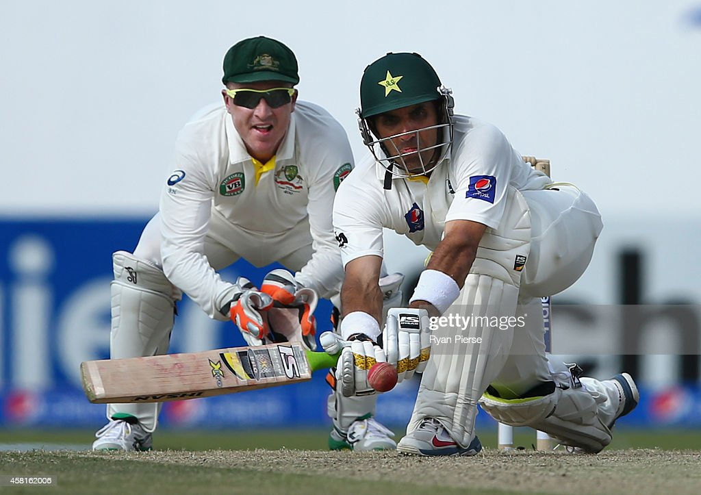 Misbah-ul Haq of Pakistan bats as <a gi-track='captionPersonalityLinkClicked' href=/galleries/search?phrase=Brad+Haddin&family=editorial&specificpeople=193800 ng-click='$event.stopPropagation()'>Brad Haddin</a> of Australia keeps wicket during Day Two of the Second Test between Pakistan and Australia at Sheikh Zayed Stadium at Sheikh Zayed stadium on October 31, 2014 in Abu Dhabi, United Arab Emirates.