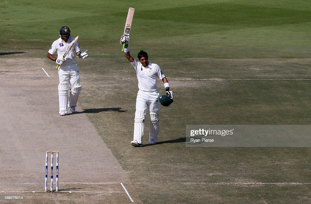 Misbah-ul Haq of Pakistan celebrates after equalling the fastest test century in history off 56 balls during Day Four of the Second Test between Pakistan and Australia at Sheikh Zayed Stadium on November 2, 2014 in Abu Dhabi, United Arab Emirates.