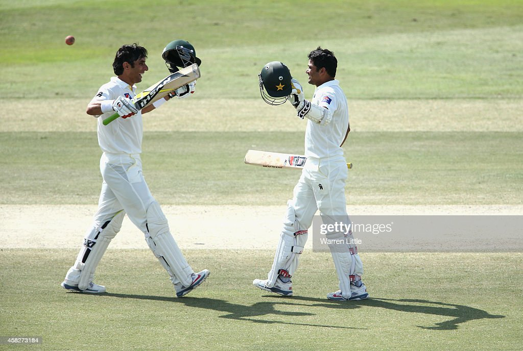 <a gi-track='captionPersonalityLinkClicked' href=/galleries/search?phrase=Misbah-ul-Haq&family=editorial&specificpeople=2180557 ng-click='$event.stopPropagation()'>Misbah-ul-Haq</a> and <a gi-track='captionPersonalityLinkClicked' href=/galleries/search?phrase=Azhar+Ali+-+Cricketer+-+Born+1985&family=editorial&specificpeople=2530383 ng-click='$event.stopPropagation()'>Azhar Ali</a> of Pakistan celebrate as they both reach their centuries during Day Four of the Second Test between Pakistan and Australia at Sheikh Zayed Stadium on November 2, 2014 in Abu Dhabi, United Arab Emirates.