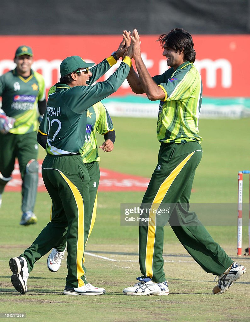 Misbah-ul-Haq and Mohammad Irfan of Pakistan celebrate the wicket of Hashim Amla of South Africa during the 5th Momentum ODI match between South Africa and Pakistan from Willowmoore Park on March 24, 2013 in Benoni, South Africa.