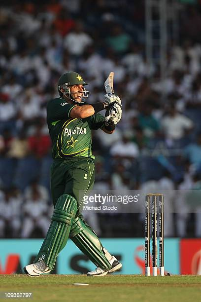 MisbahulHaq of Pakistan pulls a delivery behind square for six during the Kenya v Pakistan 2011 ICC World Cup Group A match at the Mahinda Rajapaksa...