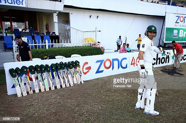MisbahulHaq of Pakistan walks past bats and caps placed outside the Pakistan dressing room in memory of Australian cricketer Phillip Hughes who died...