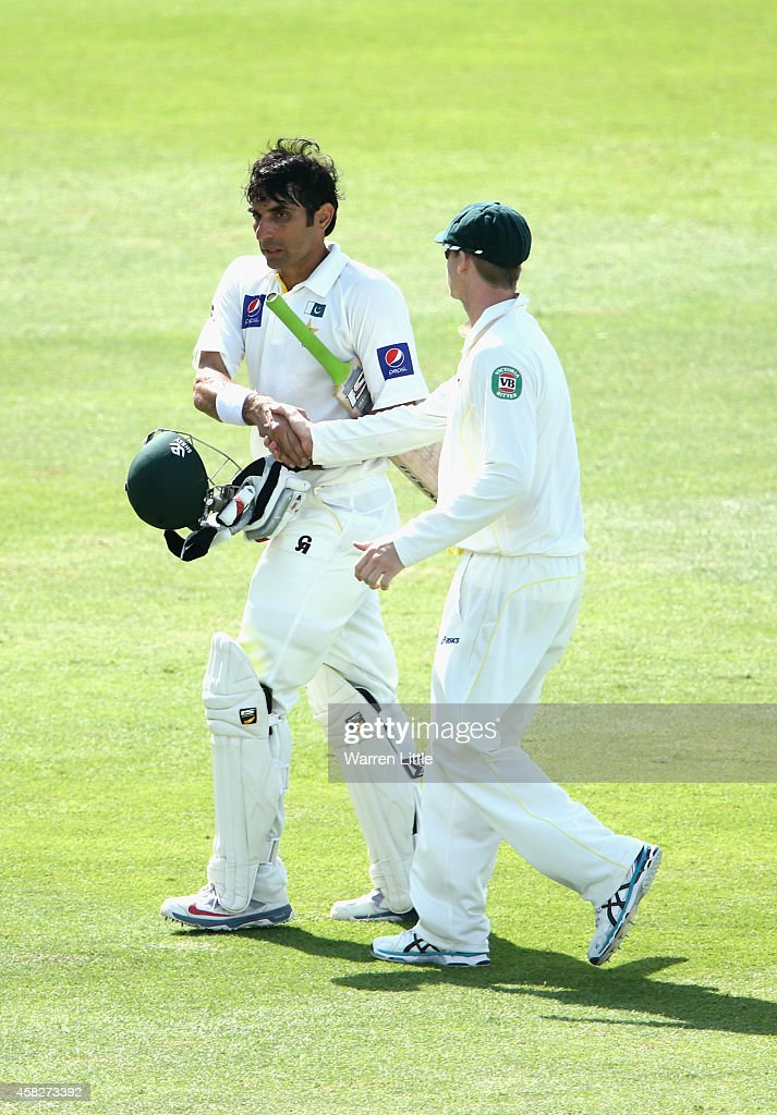 <a gi-track='captionPersonalityLinkClicked' href=/galleries/search?phrase=Misbah-ul-Haq&family=editorial&specificpeople=2180557 ng-click='$event.stopPropagation()'>Misbah-ul-Haq</a>, Pakistan Captain is congratulated after equalling the fastest ever test century during Day Four of the Second Test between Pakistan and Australia at Sheikh Zayed Stadium on November 2, 2014 in Abu Dhabi, United Arab Emirates.