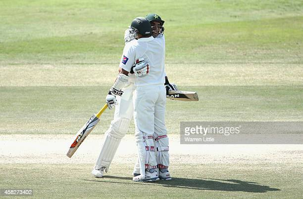 MisbahulHaq Pakistan Captain is congratulated by team mate Azhar Ali after equalling the fastest ever test century during Day Four of the Second Test...