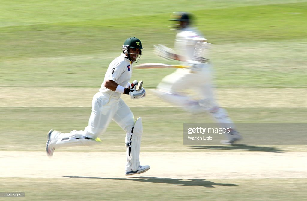 <a gi-track='captionPersonalityLinkClicked' href=/galleries/search?phrase=Misbah-ul-Haq&family=editorial&specificpeople=2180557 ng-click='$event.stopPropagation()'>Misbah-ul-Haq</a>, Pakistan Captain runs with parnter <a gi-track='captionPersonalityLinkClicked' href=/galleries/search?phrase=Azhar+Ali+-+Cricketer+-+Born+1985&family=editorial&specificpeople=2530383 ng-click='$event.stopPropagation()'>Azhar Ali</a> en route to equalling the fastest ever test century during Day Four of the Second Test between Pakistan and Australia at Sheikh Zayed Stadium on November 2, 2014 in Abu Dhabi, United Arab Emirates.