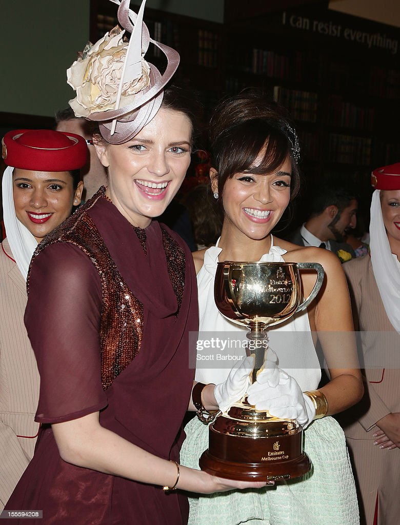 Mischa Barton and Ashley Madekwe hold the Melbourne Cup aloft at the Emirates marquee at the Melbourne Cup at Flemington Racecourse on November 6, 2012 in Melbourne, Australia.