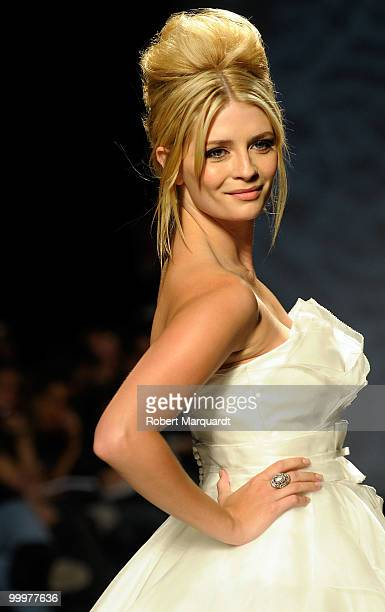 Mischa Barton presents a creation from Rosa Clara's latest bridal collection 2011 at the Fira 2 Barcelona on May 18 2010 in Barcelona Spain