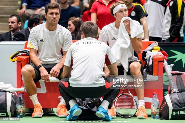 Mischa Zverev of Germany and Alexander Zverev of Germany are disappointed during day two of the Davis Cup World Group first round between Germany and...