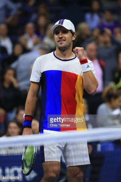 Mischa Zverev of Germany celebrates after defeating John Isner of the United States during their third round match on Day Five during the 2017 US...