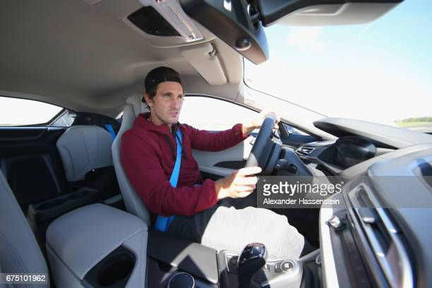 Mischa Zverev of Germany drives a BMW i8 at the BMW DrivingExperience during the BMW driving academy Maisach ahead of the 102 BMW Open by FWU at...