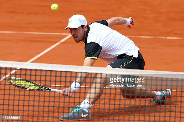 Mischa Zverev of Germany plays a back hand against Andy Murray of Scotland during the fiirst round match of the BMW Open at Iphitos tennis club on...