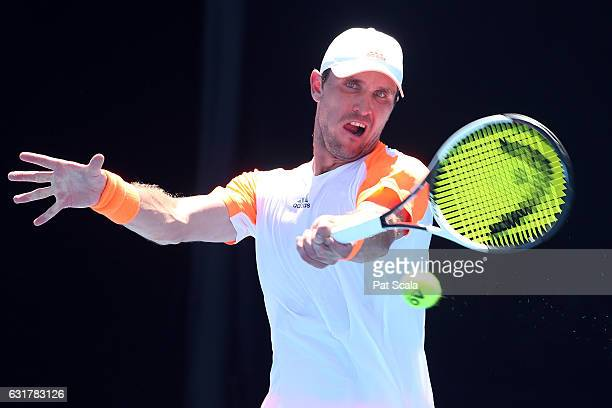 Mischa Zverev of Germany plays a backhand during his first round match against Guillermo GarciaLopez of Spain on day one of the 2017 Australian Open...