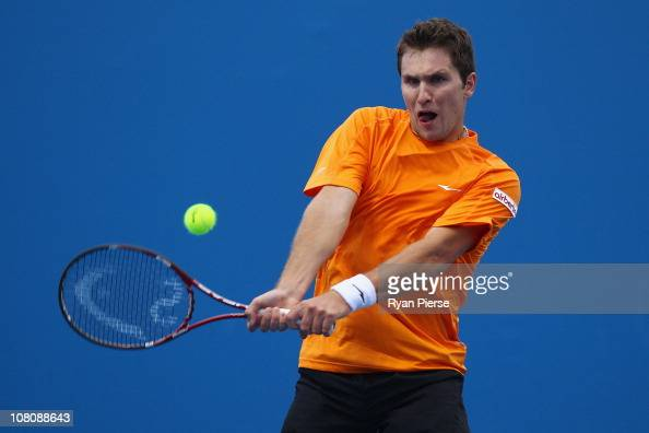 Mischa Zverev of Germany plays a backhand in his first round match against Janko Tipsarevic of Serbia during day one of the 2011 Australian Open at...