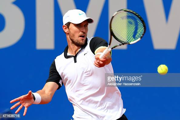 Mischa Zverev of Germany plays a fore hand against Andy Murray of Scotland during the fiirst round match of the BMW Open at Iphitos tennis club on...