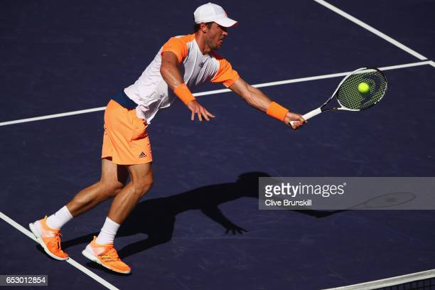 Mischa Zverev of Germany plays a forehand volley against Dominic Thiem of Austria in their third round match during day eight of the BNP Paribas Open...