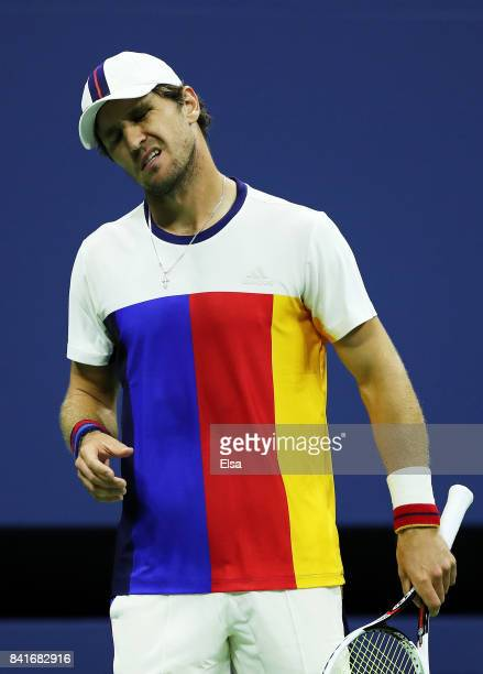 Mischa Zverev of Germany reacts in his third round match against John Isner of the United States on Day Five of the 2017 US Open at the USTA Billie...