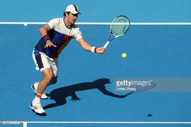 Mischa Zverev of Germany returns a shot against Nick Kyrgios of Australia during the Men's singles second round on day five of 2017 China Open at the...