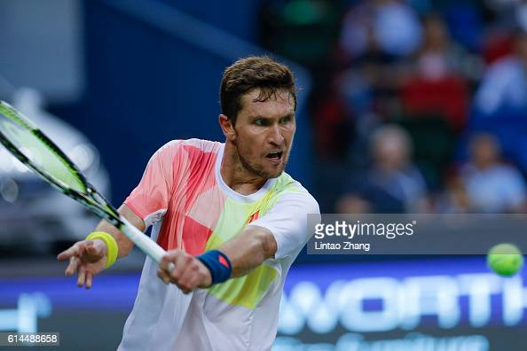 Mischa Zverev of Germany returns a shot against Novak Djokovic of Serbia during day six of Shanghai Rolex Masters at Qi Zhong Tennis Centre on...