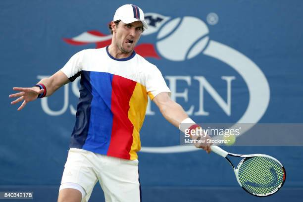 Mischa Zverev of Germany returns a shot during his first round Men's Singles match against ThaiSon Kwiatkowski of the United States on Day One of the...
