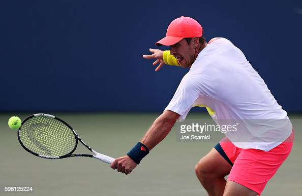 Mischa Zverev of Germany returns a shot to Jack Sock of the United States during his second round Men's Singles match on Day Three of the 2016 US...