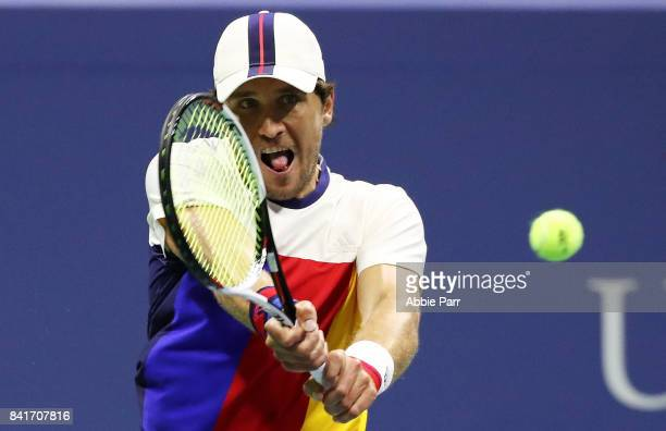 Mischa Zverev of Germany returns a shot to John Isner of the United States during their third round match on Day Five of the 2017 US Open at the USTA...