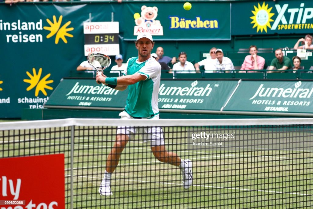 Mischa Zverev of Germany returns the ball during the men's singles match against Roger Federer of Switzerland on Day 6 of the Gerry Weber Open 2017 at Gerry Weber Stadion on June 22, 2017 in Halle, Germany.