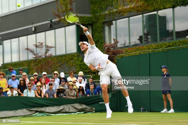 Mischa Zverev of Germany serves during the Gentlemen's Singles first round match against Bernard Tomic of Australia on day two of the Wimbledon Lawn...