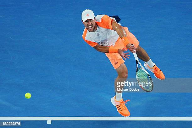 Mischa Zverev of Germany serves in his quarterfinal match against Roger Federer of Switzerland day nine of the 2017 Australian Open at Melbourne Park...