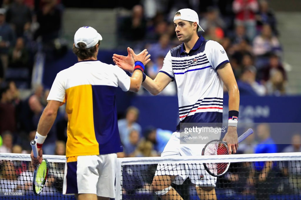 Mischa Zverev of Germany shakes hands with John Isner of the United States sfter defeating him in their third round match on Day Five of the 2017 US Open at the USTA Billie Jean King National Tennis Center on September 1, 2017 in the Flushing neighborhood of the Queens borough of New York City.