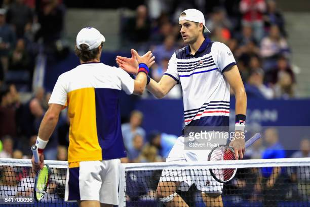 Mischa Zverev of Germany shakes hands with John Isner of the United States sfter defeating him in their third round match on Day Five of the 2017 US...