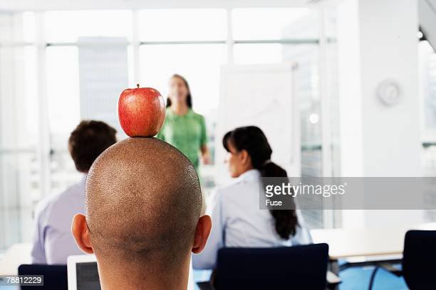 Mischievous Businessman During a Presentation